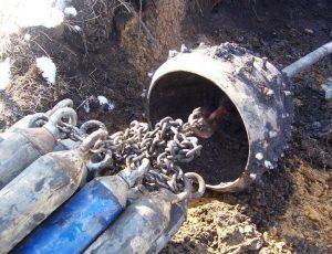 Vtahovaní svazku potrubí 12x110m bezvýkopovou technologií pomocí rozšiřovací vrtné hlavy